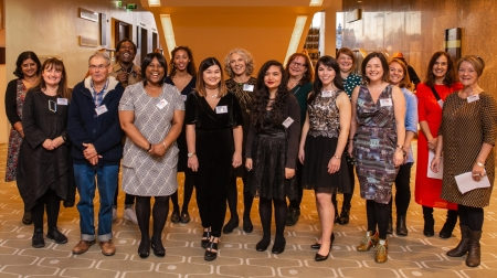 The twelve finalists in our finest outfits standing grouped together smiling at the camera. I am one of them. There are also two members of the CF team, Lemn Sissay and Kaerry Hudson.