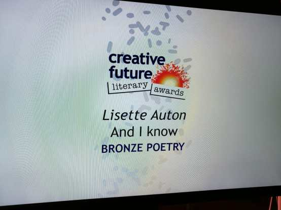 photo description: a still shot of a tv screen with the Creative Future Literary Awards logo and the text - Lisette Auton And I Know Bronze Poetry