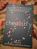 photo description: front cover of the book Chemistry lying on my multi coloured rug