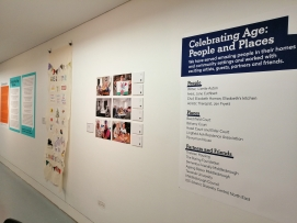 photo description: a gallery wall showing photos and a banner as part of the Celebrating Age project