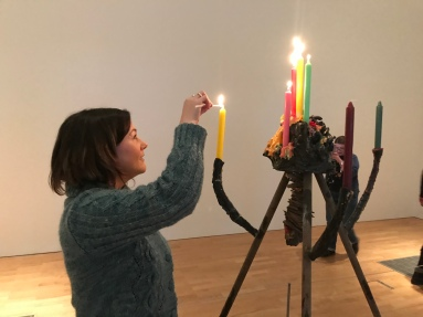 Lighting the candles at the opening of the Chiara Camoni - Sisters exhibit at mima