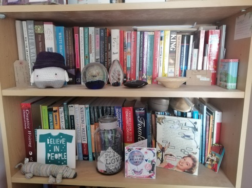 two of my bookshelves full of 'How-To' books and assorted keep-sakes such as crocheted toys, paperweights and cards