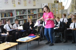 me working with a group of school children, I'm wearing a bright pink Tshirt which says - Do Stuff With Words