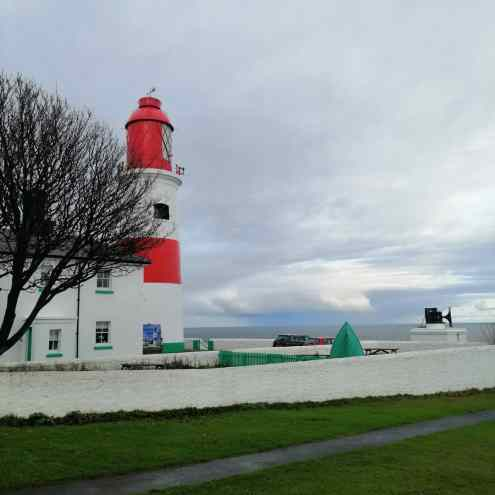 red and white Souter Lighthouse, and its fog horn stand looking out to sea. The Wrecklings is set here.