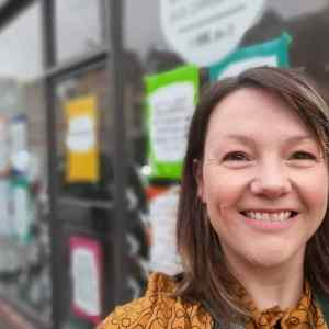 Me smiling outside our Walthamstow shop front