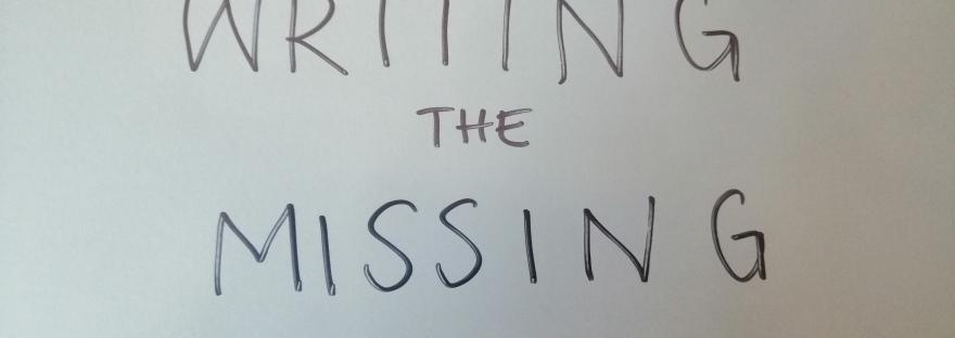 photo description: My grey folder. Written on it in capital letters in black sharpie is WRITING THE MISSING
